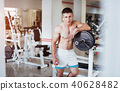 Beautiful man with big muscles, posing for the camera 40628482