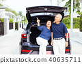 Happy Asian senior couple standing on back of car 40635711