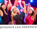 Happy people in Santa hats 40644929