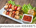 Grilled chicken skewers on the white plate 40648875
