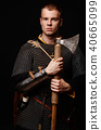 Male medieval warrior in armour and chain mail 40665099