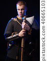 Male medieval warrior in armour and chain mail 40665103