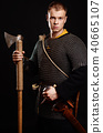 Male medieval warrior in armour and chain mail 40665107