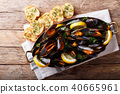 Copper pot of gourmet mussels with lemon, parsley 40665961