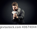 Man with playing cards on a dark background 40674044