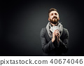 Man with playing cards on a dark background 40674046