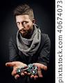 man holding poker chips 40674073