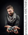 man holding poker chips 40674085