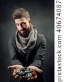 man holding poker chips 40674087