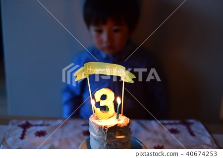 Childs 3 Year Old Birthday Blow Out A Cake Candle