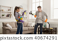 Young couple cleaning home, playing with mop 40674291