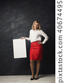 Businesswoman with blank white paper 40674495