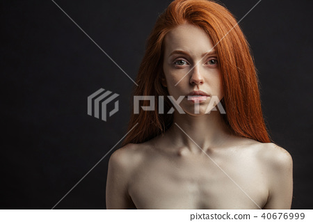 Slim young sex appealing girl with long gorgeous red hair on bla 40676999