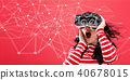 Links with woman using a virtual reality headset 40678015