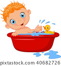 Cartoon baby in a bubble bath splashing water 40682726