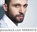 Handsome man in white shirt. Closeup portrait. 40684076