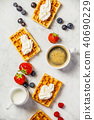 Traditional belgian waffles with whipped cream and fresh fruits  40690229