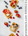 Traditional belgian waffles with whipped cream and fresh fruits  40690231