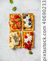 Traditional belgian waffles with whipped cream and fresh fruits  40690233