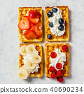 Traditional belgian waffles with whipped cream and fresh fruits  40690234