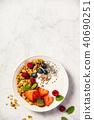 Bowl of homemade granola with yogurt and fresh berries 40690251