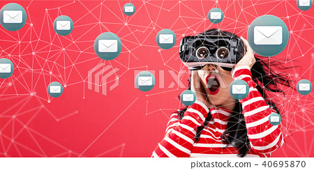 Emails with woman using a virtual reality headset 40695870