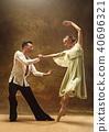 Flexible young modern dance couple posing in studio. 40696321