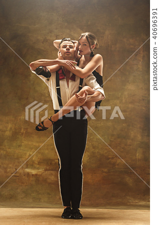Flexible young modern dance couple posing in studio. 40696391