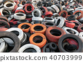 Red white orange and black waste car tires piled 40703999