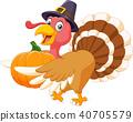 Thanksgiving turkey mascot holding pumpkin with ha 40705579