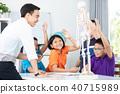 teacher explains a human body structure to pupil. 40715989