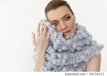 Beautiful woman in warm scarf 40716211