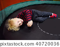 Fanny little boy after activity on trampoline 40720036
