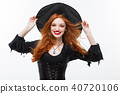 Halloween witch concept - Happy Halloween ginger hair Witch. Isolated on white background. 40720106