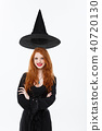 Halloween witch concept - Happy Halloween Sexy ginger hair Witch with magic hat flying over her head 40720130