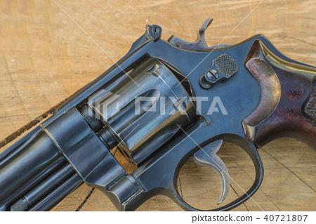 Handgun close up on wooden background 40721807