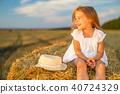 girl hay sitting 40724329