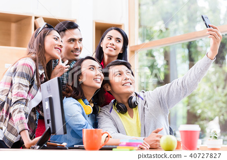 Creative team of five enthusiastic employees making a selfie photo 40727827