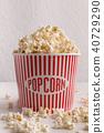 Bucket of popcorn on white background 40729290