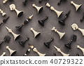 Chess figures on gray table background 40729322