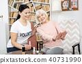 Vigorous senior woman admiring manicure 40731990