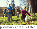 Inspired team gathering litter in the forest 40741673