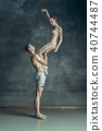 The young modern ballet dancers posing on gray studio background 40744487