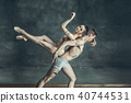 The young modern ballet dancers posing on gray studio background 40744531