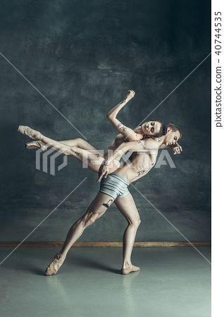 The young modern ballet dancers posing on gray studio background 40744535
