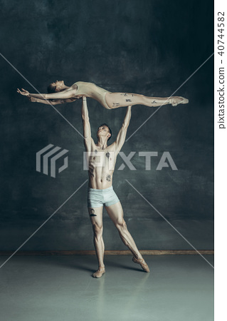 The young modern ballet dancers posing on gray studio background 40744582