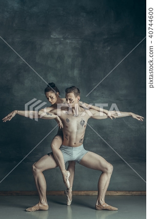 The young modern ballet dancers posing on gray studio background 40744600