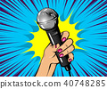 Woman pop art hand hold microphone 40748285