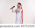 Arabian boy in keffiyeh with microphone  40753505
