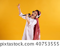 Arabian boy in keffiyeh with microphone  40753555